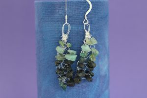 emerald_knitted_earrings_hanging_scaled