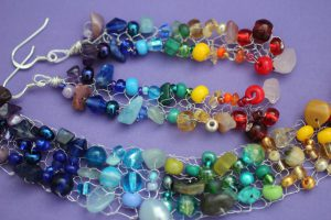 Aquamarine features in these beautiful rainbow pieces