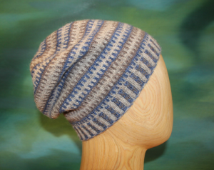 Slouchy broken striped hat seen in side view